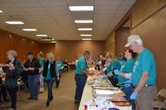 Volunteers Serving